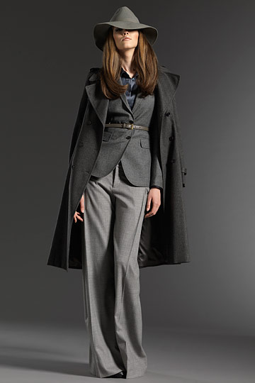 Coat, hat and trousers by Gucci