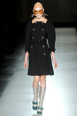 Black coat with silver boots by Prada